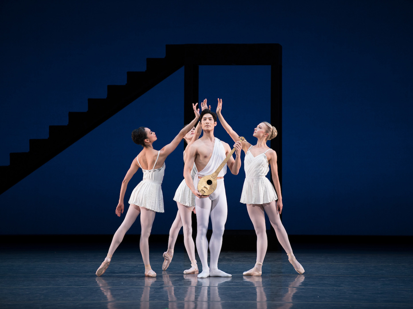 Stella Abrera (Terpsichore), Melanie Hamrick (Calliope), Joo Won Ahn (Apollo) and Katherine Williams (Polyhymnia) in <i>Apollo</i>. © The George Balanchine Trust. Photo: Rosalie O'Connor.