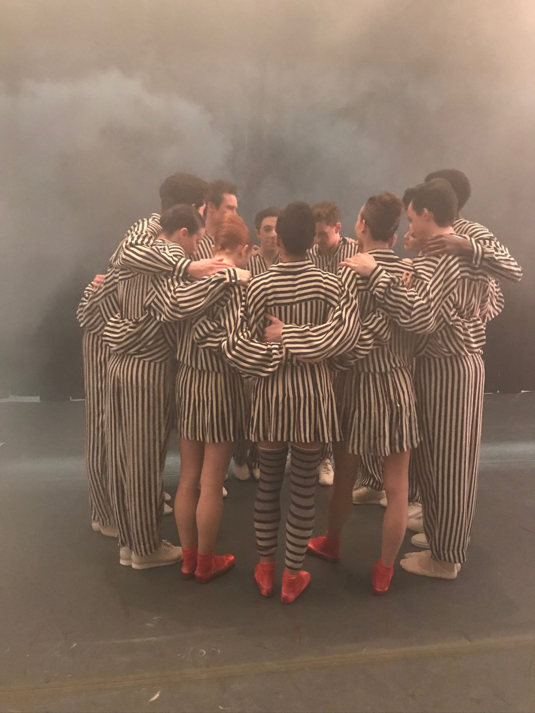 Cast of <i>In the Upper Room</i> gathers on stage before the show (2019). Photo courtesy Carlos Gonzalez.