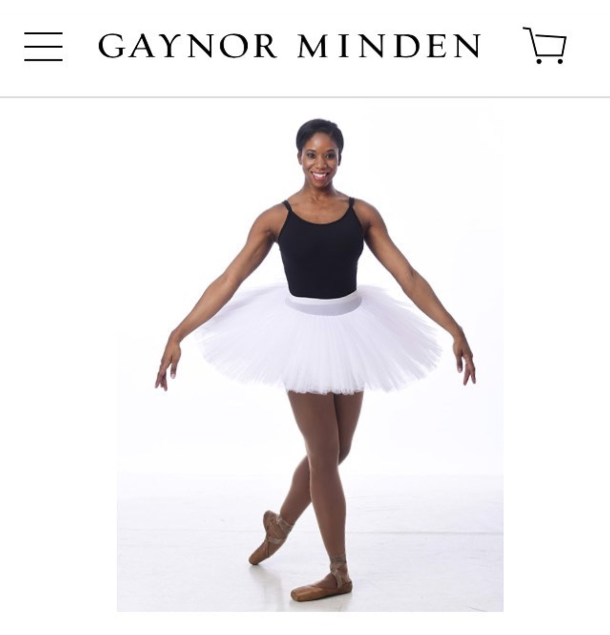 Annellyse models skin tone tights and pointe shoes for Gaynor Minden.