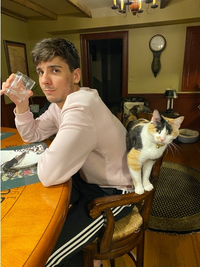 João with the cat, Lucky.