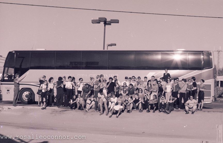 The Company gathers for a group picture in front of one of their buses during their cross-country journey on September 12 and September 13, 2001. Photo: Rosalie O'Connor.