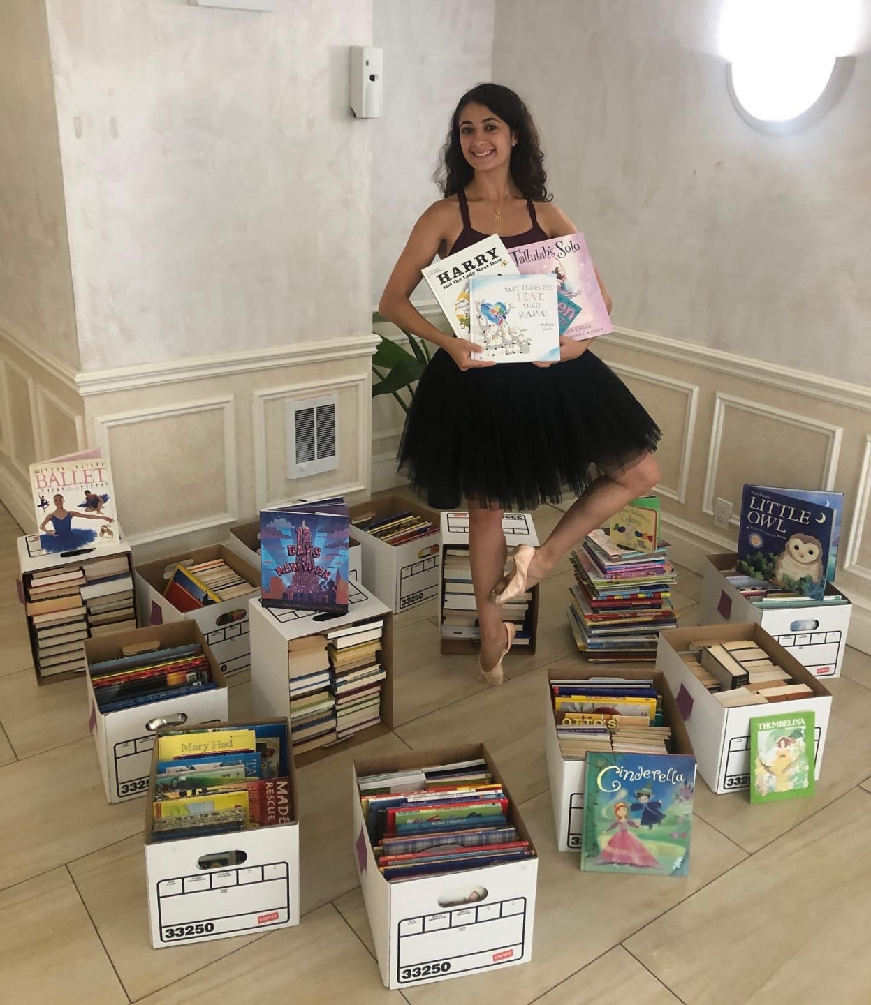 Lauren Bonfiglio with books collected for her ABT book drive.